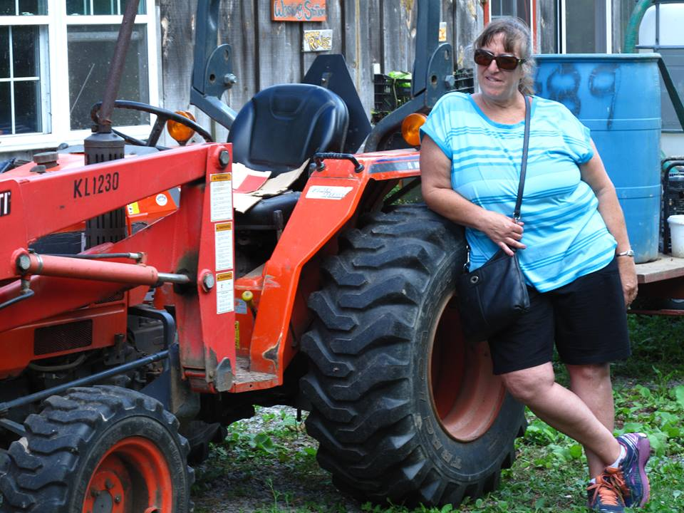 fran_leaning_on_tractor
